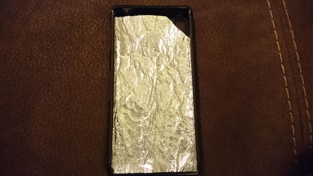 Kitchen foil is a quick fix for overheating issues. Photo: schecter7